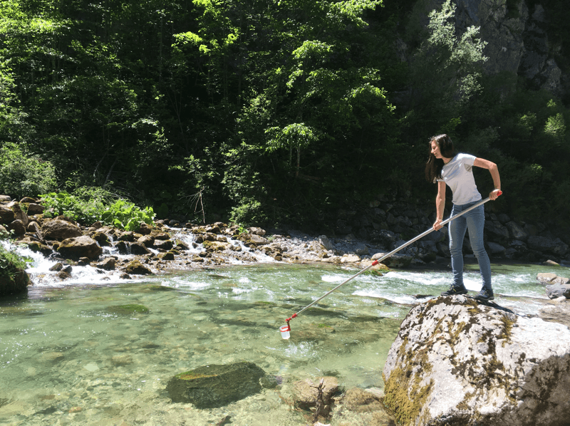 Grabbing surface water samples during sampling campaign in Slovenia 2016.